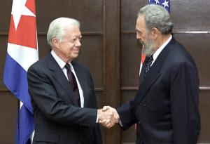 HAVANA - MAY 12: Former US President Jimmy Carter (L) shakes hands with Cuban President Fidel Castro 12 May, 2002, at the State Council in Havana, where Castro, Carter and their respective delegations met for a working meeting. Carter is on a five-day visit to Cuba, invited by Castro. (Photo by Adalberto ROQUE/AFP/Getty Images)